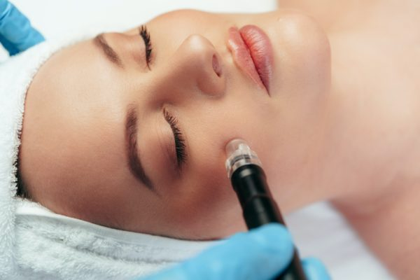Beautiful woman getting facial skincare treatment in a cosmetic beauty clinic