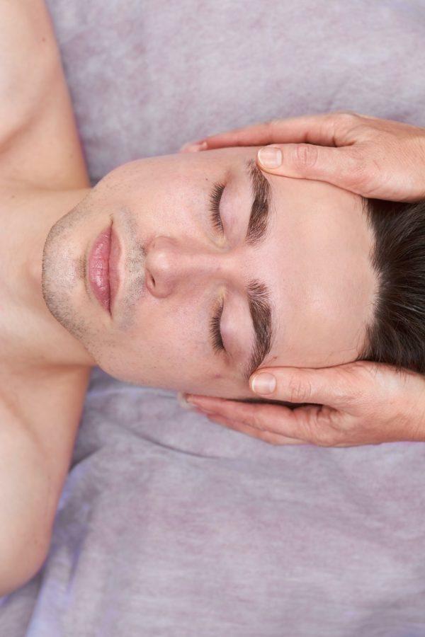Young man, facial massage