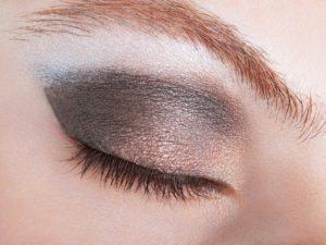 Woman eye with bronze smokey make up
